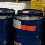 blue drums with raw chemicals inside